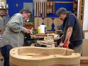 Guitar Building Class - Student carving a heel